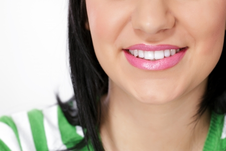 dentition:  smiling young woman with beautiful teeth