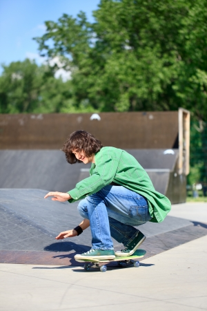 Skater boy practicing at a skate park photo