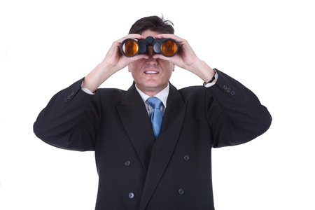 Senior man observing through binoculars isolated over white background photo