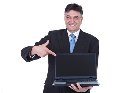 senior businessman holding laptop and pointing in empty screen, isolated on white background photo