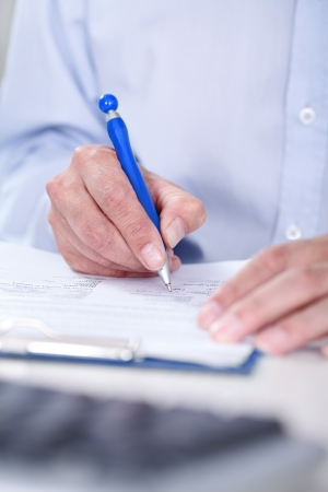 Businessman with pen signing contract photo