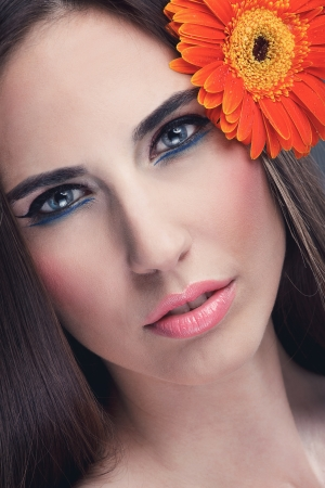 sensual young woman with make-up and flower in hair photo