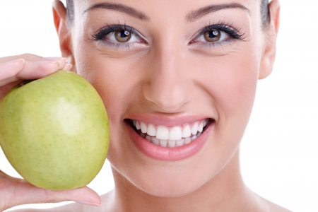 smile close up: great healthy smile with green apple