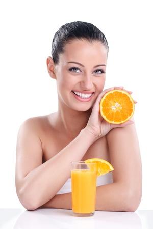 Beautiful girl with natural orange juice, healthy food photo