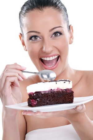 eating chocolate:  excited young woman eating tasty, chocolate cakes