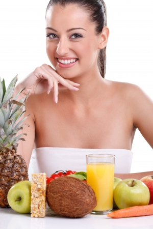 Young smiling woman with fruits and vegetables, over white background photo