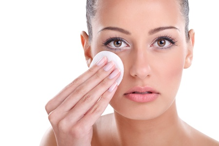 young beautiful woman cleaning face with cotton pad Stock Photo