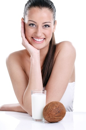 coconut milk:  Young smiling girl with coconut milk, isolated on white background