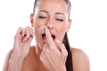 Beautician depilating, young woman getting waxing mustache Stock Photo