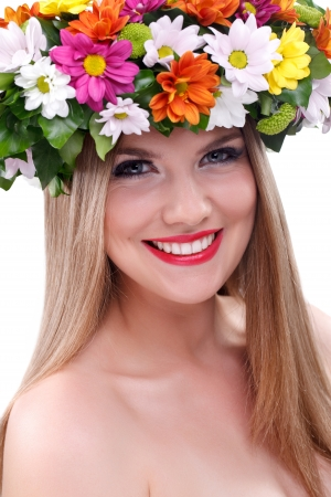 Young woman with flowers on her hair photo