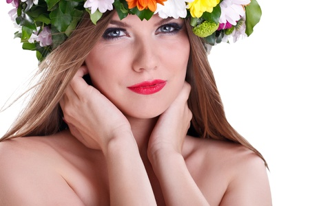 Close up of tender, beautiful woman with flower in hair photo