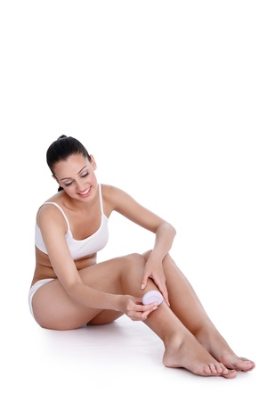 Woman depilating her legs with removal wax Stock Photo - 14332270