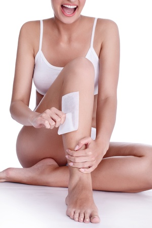 young woman doing depilation for her legs with waxing Stock Photo - 14332404