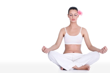 meditation isolated white:  Portrait of healthy young woman practicing yoga in the lotus position