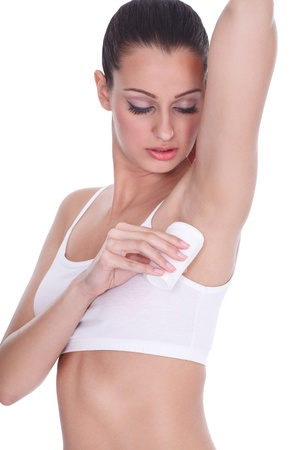 Young woman applying anti perspirant photo