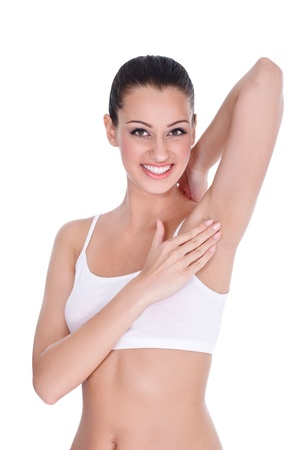 Smiling woman touching her clean armpit- isolated on white photo