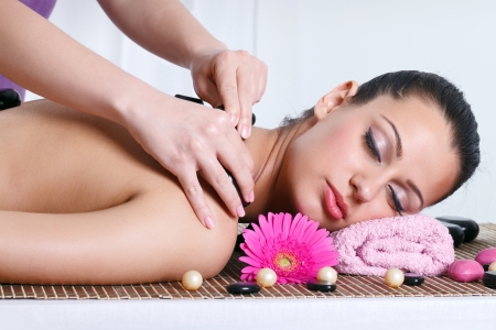 attractive caucasian woman lying down on a massage bed at a spa photo