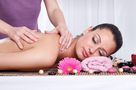 young woman receiving back massage at spa center Stock Photo - 14332492
