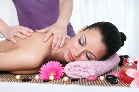 day spa: Young female getting a body massage at the day spa Stock Photo