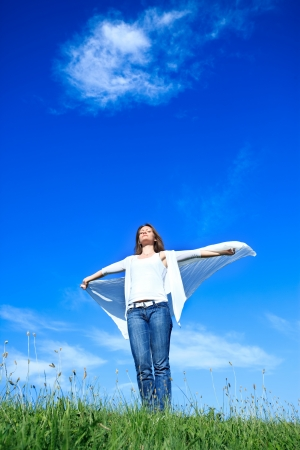 enjoy space: Beautiful Young Woman over blue Sky