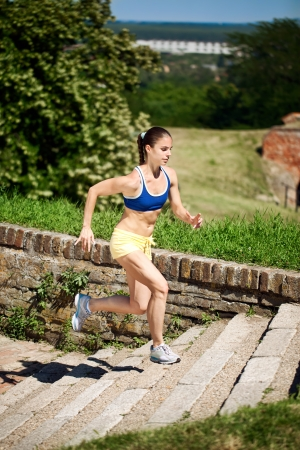 stone stairs: Young athlete running on stairs outdoors