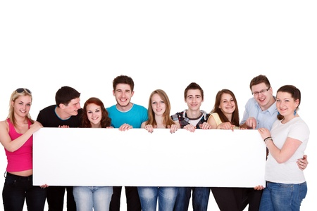 Happy smiling group of friends standing together in a row and displaying a white billboard photo