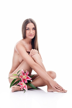 Beautiful woman body with pink lily flower, isolated on white background photo