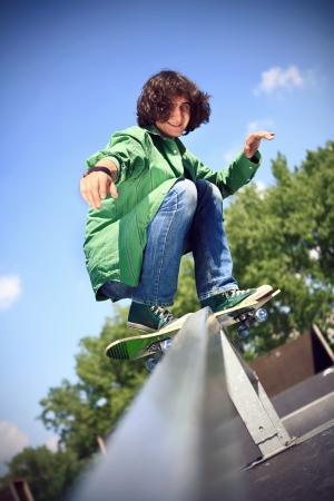 skate park: Boy practicing skate in a skate park Stock Photo