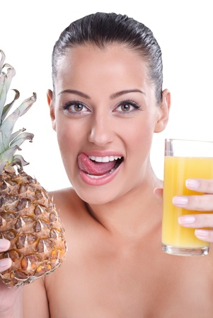 thirsty woman holding glass of pineapple juice and licks his lips photo