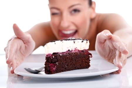 woman eating cake:  girl takes a piece of cake Stock Photo