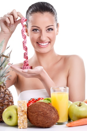 Smiling woman with healthy food and measuring tape, concept-diet  photo