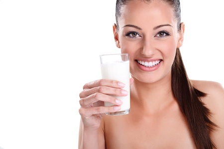 Beautiful healthy woman with glass of milk photo