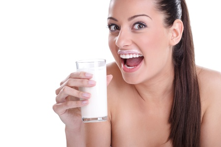 Funny and happiness woman with glass of milk or yogurt photo