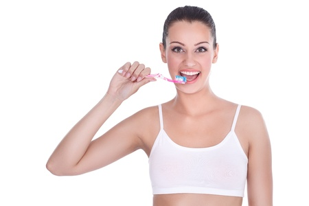 Happy young woman with tooth-brush- isolated on white Stock Photo - 14734462