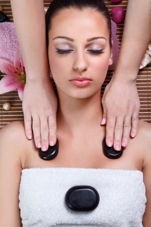 Close-up of a woman receiving a massage with stone in a spa center Stock Photo - 14734822