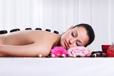 Relaxed woman in spa center with hot stone on back Stock Photo - 14734549