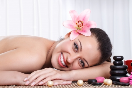 Beautiful young woman getting hot stone therapy at spa salon Stock Photo - 14734716