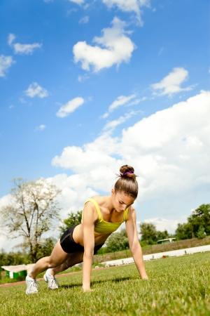 sit ups:  Athlete woman doing exercising