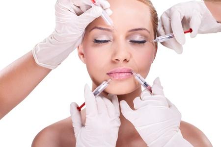 botox: Plastic surgeons giving injection of botox