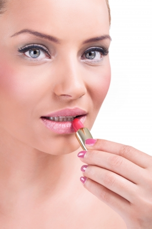 Portrait of beautiful woman applying lipstick, copy space  photo