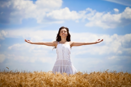outstretched arms: woman with outstretched arms enjoying in summer field