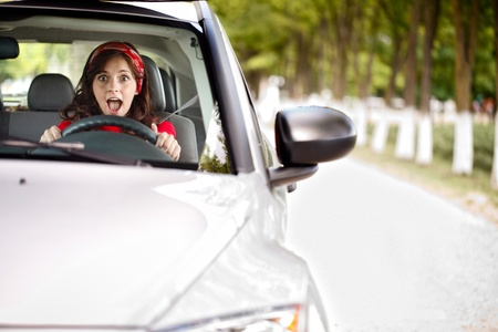 young woman stopping the car and screaming photo