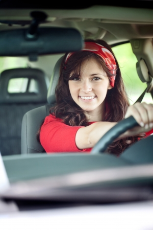 A happy girl rides in her new car. Stock Photo - 14734536