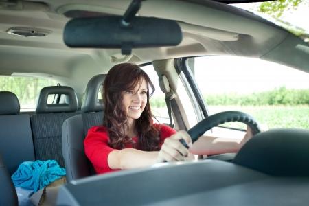 Beautiful young girl driving car photo