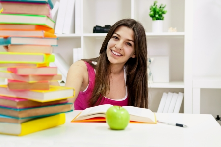 close-up portrait of a beautiful young female student, very happy and with a big smile  photo