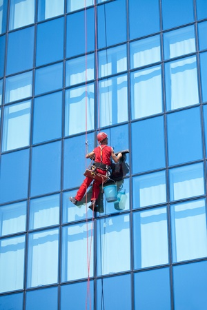 window washer on modern office building Stock Photo