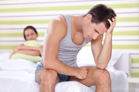 erotic couple:  Unhappy young couple with problem  in bedroom Stock Photo