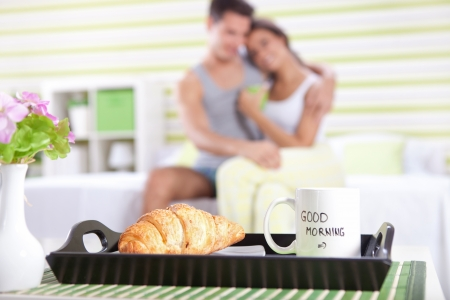 good morning,  happy couple in bed with breakfast in focus photo