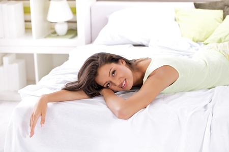 bed sheet: Beautiful woman relaxing on bed, bedtime in morning