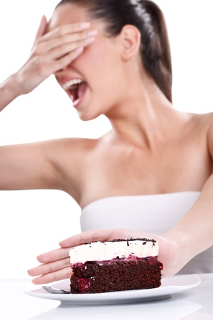 resolved: Diet concept- resolute woman refuses to eating tasty cake